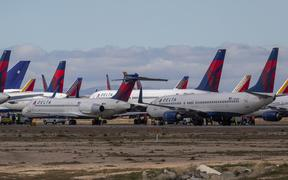 VICTORVILLE, CA - MARCH 24: Delta Air Lines jets are parked in growing numbers at Southern California Logistics Airport (SCLA) on March 24, 2020 in Victorville, California.