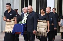 Bill Sevesi's family carries his coffin at his funeral in Auckland.