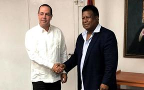 Cuba's Minister for Public Health Roberto Morales Ojeda( left) and Palau Health Minister Emais Roberts during a 2018 visit of Palau