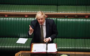 A handout photograph released by the UK Parliament shows shows Britain's Prime Minister Boris Johnson attending Prime Minister's Question time (PMQs) in the House of Commons.