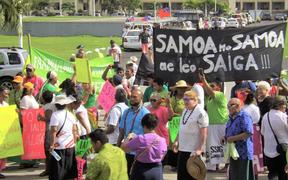 Around 100 people protested outside Samoa's parliament