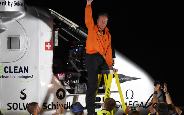 Swiss pilot Andre Borschberg emerges from the cockpit after successfully landing the Solar Impulse 2.