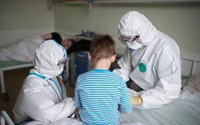 Medical workers in Russia's National Medical Research Center for Children's Health where children with COVID-19 coronavirus infection are treated, in Moscow.