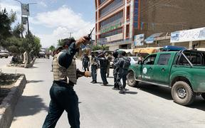 Afghan security forces inspect the scene after gunmen attack to Medicins Sans Frontieres (MSF) clinic.