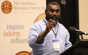 Ishmael Toroama speaking at PNG think-tank, The National Research Institute.