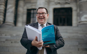 Grant Robertson holding the Budget 2020 ahead of its release.