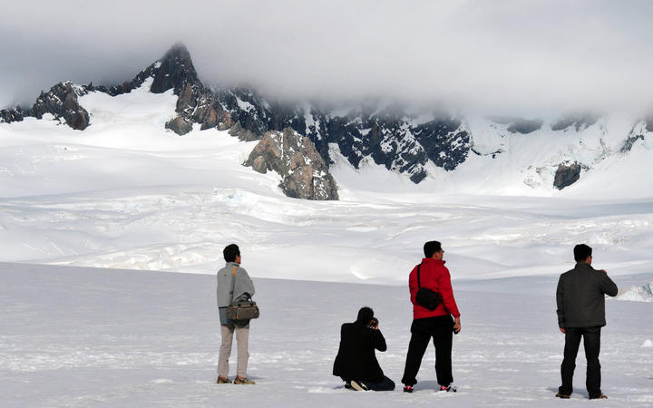 Tourists on Fox Glacier in 2009,