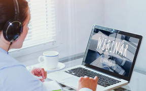 Woman watching webinar online on computer, business education concept, coaching.