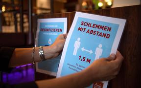 Stickers with hygiene regulations are hung up in a restaurant in Bremen, Germany, on 18 May, 2020.