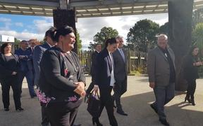 Prime Minister Jacinda Ardern, centre, walks on to Te Puia tourism centre in Rotorua. Te Puia and the Māori arts and crafts training centre will receive $7.6 million from the government to safeguard its future.