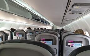 Passengers sitting at a distance from each other on an Air New Zealand flight from Christchurch to Queenstown on 14 May,
