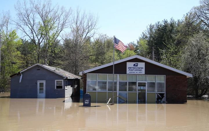 SANFORD, MICHIGAN - MAY 20: Main street is flooded after water from the Tittabawassee River breached a nearby dam on May 20, 2020 in Sanford, Michigan.