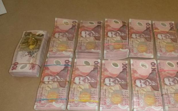 One person was found with almost $400,000 cash, during hte police raid.