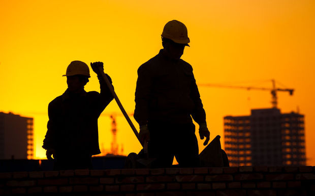 Silhouette of a construction worker.