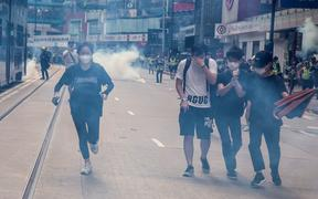Police fire tear gas on protesters during a planned protests against a proposal to enact a new security legislation in Hong Kong on May 24, 2020.