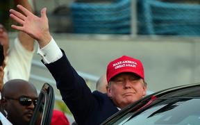 Republican Presidential candidate Donald Trump waves as leaves following a speech on board the Worl War II bettlaship USS Iowa in San Pedro, California on September 15, 2015.