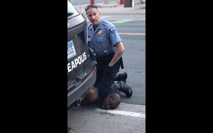 This still image taken from a May 25, 2020, video courtesy of Darnella Frazier via Facebook, shows a Minneapolis, Minnesota, police officer arresting George Floyd.