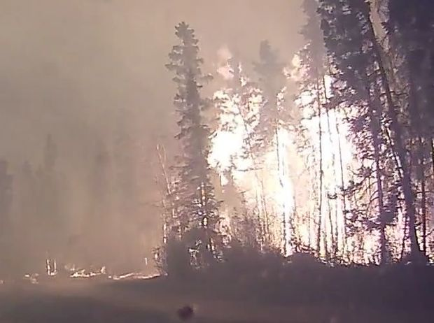 A dashcam video of residents evacuating the Canadian city of Fort McMurray Fire  during a massive forest fire.