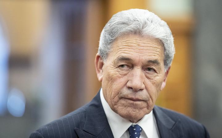 Winston Peters speaks to media on his way to the debating chamber in Parliament, Wellington.