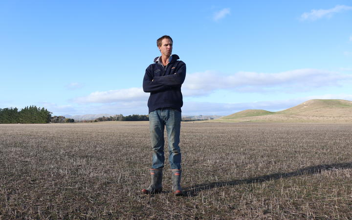 Simon White of Ludlow Farms in Ōtāne, Central Hawke's Bay on a drought-stricken field which would usually see grass in March.