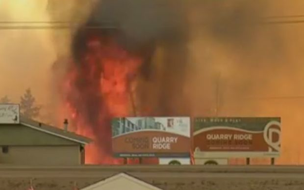 Flames close in on buildings in Fort McMurray.