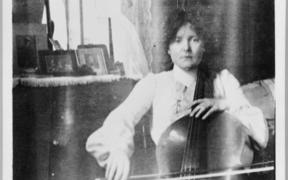 Katherine Mansfield playing the cello at Queen's College, London c.1903-1905.