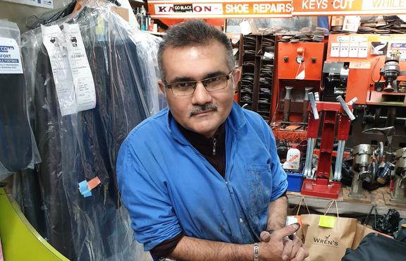 Raj runs the shoe repair shop tucked away in the James Cook Arcade.