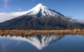 A view of Mt Taranaki over a waterway.
