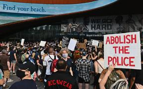 "Protesters gather during a ""Black Lives Matter"" protest near Barclays Center on May 29, 2020 in the Brooklyn borough of New York City, in outrage after George Floyd, an unarmed black man, died while being arrested"