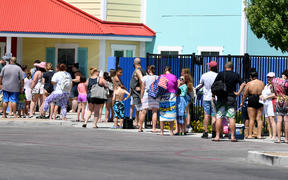 Guests line up to get into Cowabunga Bay Water Park, which was allowed to open for the first time this weekend because of the coronavirus pandemic
