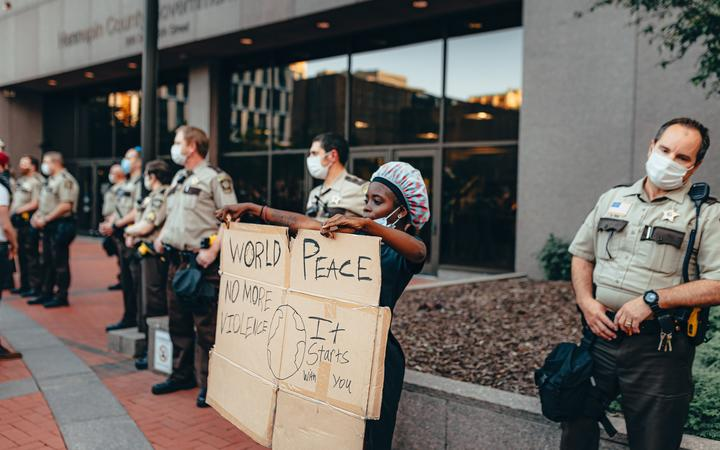 A demonstrator in Minneapolis, MN, during George Floyd protests.