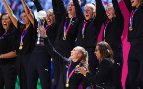 The Vitality Netball World Cup 2019 winners, Silver Ferns' Laura Langman with the trophy during the medal ceremony.