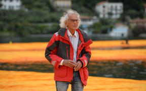 "Artist Christo Vladimirov Javacheff walks on his monumental installation ""The Floating Piers"" he created with Jeanne-Claude at the lake Iseo, northern Italy, on June 16, 2016."