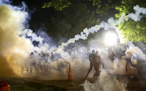Tear gas rises as protesters face off with police during a demonstration outside the White House on 31 May over the death of George Floyd at the hands of Minneapolis Police.