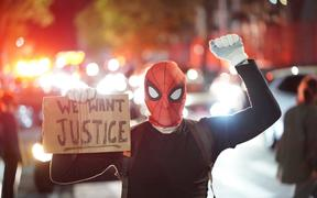 Protestor in a spiderman mask rally against the death of Minneapolis, Minnesota man George Floyd at the hands of polic.