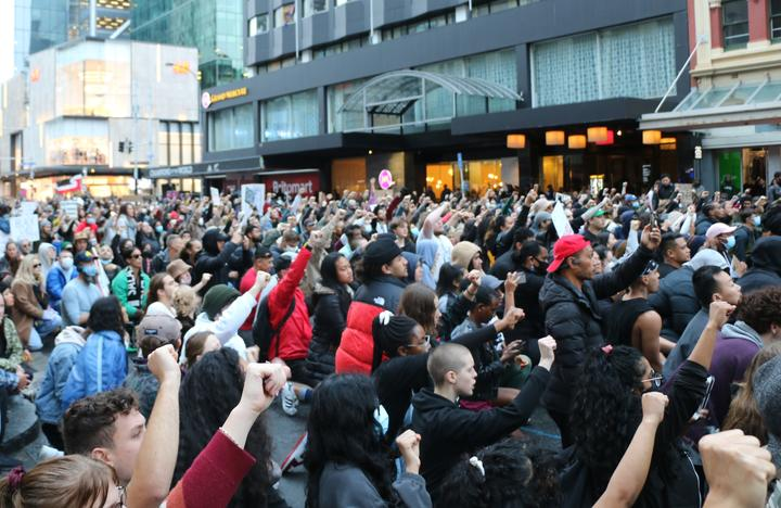Protesters took a knee with fists up outside the US embassy building in Auckland on 1 June, 2020, chanting