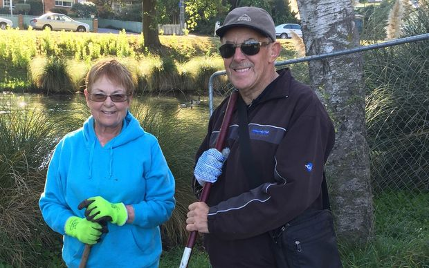 Volunteers Liz and Neville Barrie by the Avon with their haul of rubbish.