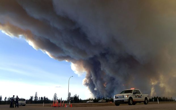 The ferocious wildfire wreaking havoc in Canada has doubled in size.