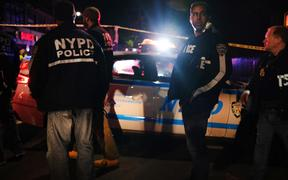 NEW YORK, NEW YORK - JUNE 03: Police gather at the scene where two New York City police officers were shot in a confrontation late Wednesday evening in Brooklyn on June 03, 2020 in New York City.