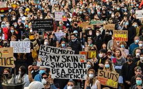Demonstrators attend a Black Lives Matter protest to express solidarity with US protestors in Sydney on June 6, 2020 and demand an end to frequent Aboriginal deaths in custody in Australia.