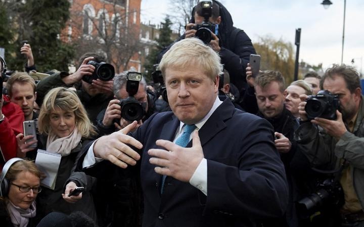 London Mayor Boris Johnson (C) delivers a statement to the media regarding his position on the forthcoming EU referendum outside his home in London on February 21 , 2016 - London mayor Boris Johnson on February 21 said he would support a vote for Britain to leave the European Union