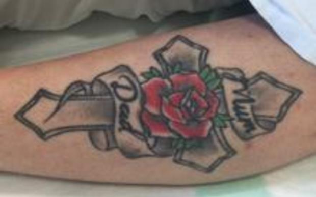 Police are trying to identify a woman with this tattoo, after she was found with serious head injuries north of Auckland.