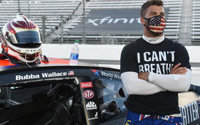 "Nascar driver Bubba Wallace wears a ""I Can't Breathe - Black Lives Matter"" t-shirt."
