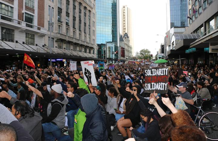 Black Lives Matter protesters take a knee outside the US consulate in central Auckland on 14 June, 2020.