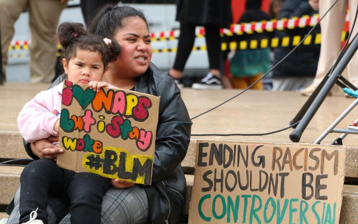 Protesters with their signs in Aotea Square, Auckland at the Black Lives Matter rally on 14 June, 2020.