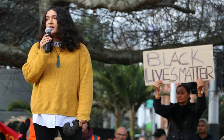 Emilie Rākete from People Against Prisons Aotearoa and the Arms Down movement speaks at the Black Lives Matter protest at Aotea Square in Auckland, on 14 June, 2020.