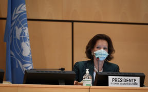 The president of the Human Rights Council, Austrian Ambassador Elisabeth Tichy-Fisslberger, wearing a protective face mask during a UN Human Rights Council session on June 15, 2020 in Geneva.