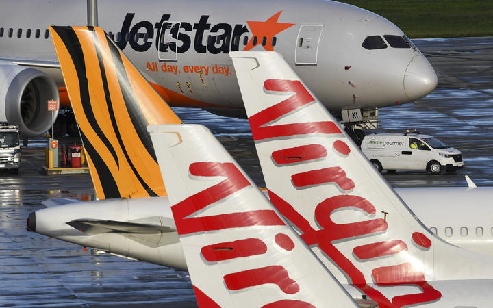 Jetstar, Tiger and Virgin planes sit idle on the tarmac at Melbourne's Tullamarine Airport on 12 April 2020.