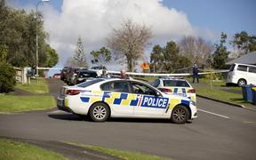 Officers at the scene of a police shooting in Massey, Wellington, 19 June 2020.