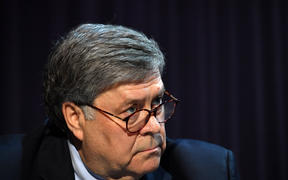 US Attorney General William Barr looks on during a roundtable with US President Donald Trump,faith leaders and small business owners at Gateway Church Dallas Campus in Dallas, Texas, on June 11, 2020.